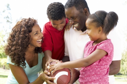 Family playing with football